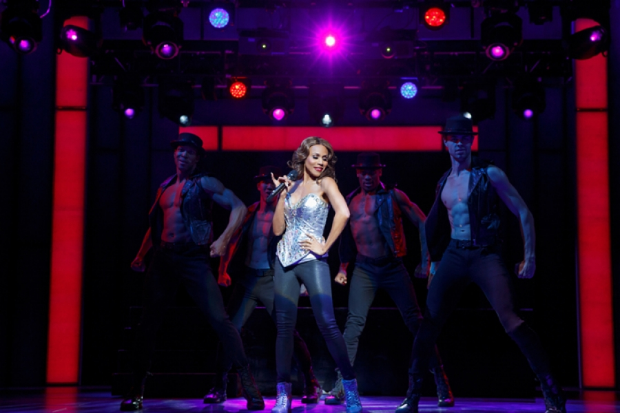 "Deborah Cox as Rachel Marron and the company of ""The Bodyguard"" presented by Broadway Sacramento April 18 – 23, 2017 at the Sacramento Community Center Theater. Photo by Joan Marcus."