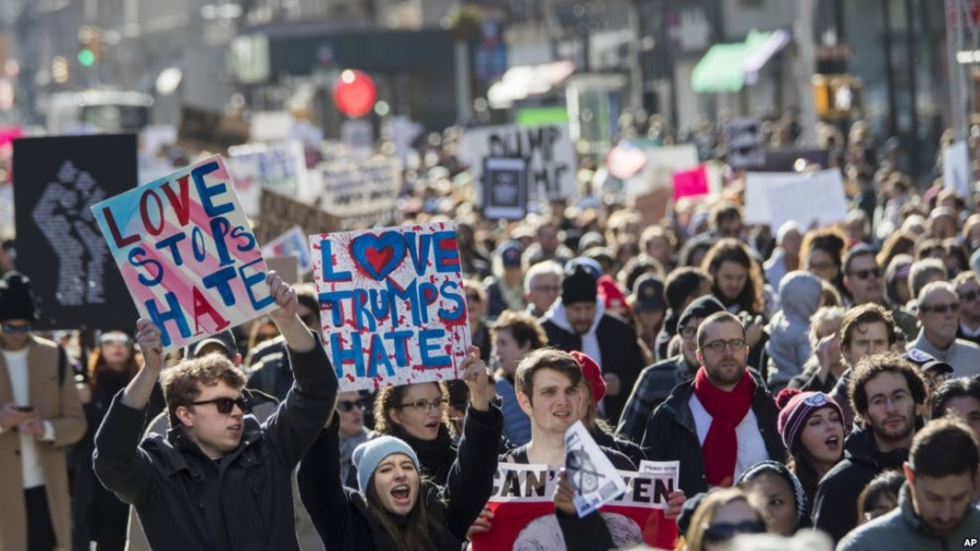 Thousands march in U.S. cities against Trump presidency