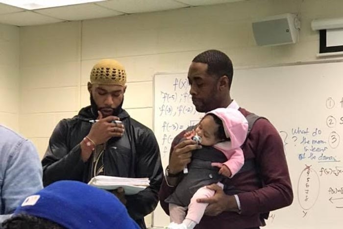 A student brought his baby to class because he didn't have child care. His professor lent a hand.