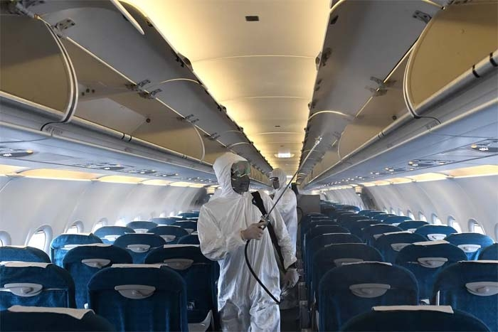 Can't avoid flying during coronavirus pandemic? Here's how to disinfect your airplane seat