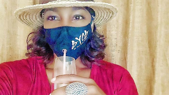 Marketing Exec Sheila Coates Creates a Drinking Mask for Social Distancing Happy Hours