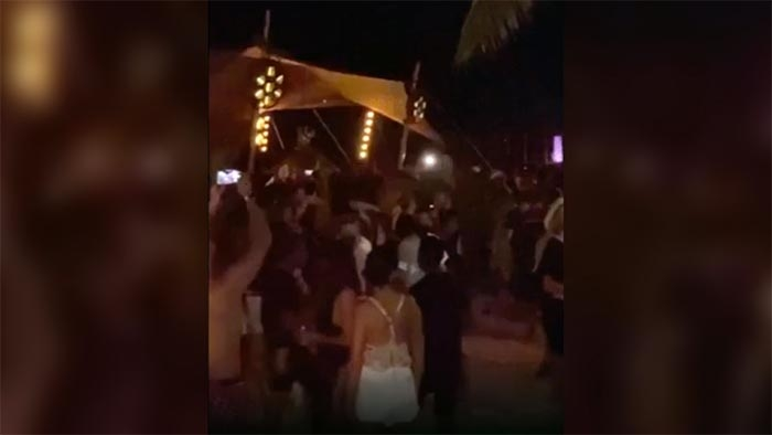Festival apologizes over packed, maskless beach parties in Mexico